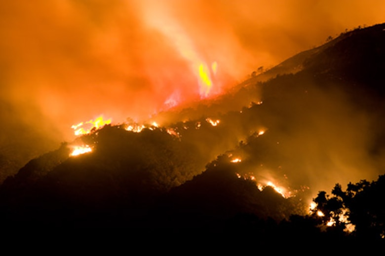 Flames and glow from out of control wildfire with large swirl of flame in Napa County, Calif., Oct. 10, 2017. Active wildfires in California have burned an estimated 1,500 homes and commercial structures, scorched more than 115,000 acres and reportedly killed 15 people.