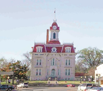 The Chase County Courthouse is nested in the city of Cottonwood Falls, at the end of Broadway Street. This 1872 French Renaissance inspired building was designated one of the 8 Wonders of Kansas Architecture and is located one block south of the museum.