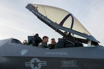 Col. David Mineau is shown the F-35A Lightning II cockpit after it landed for the first time at Eielson Air Force Base, Alaska.