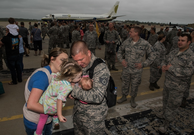 U.S. Air Force Staff Sgt. Spencer Chamber, 1st Maintenance Squadron metals technology technician, hugs his new born baby Xanthe, who he has never met, after his return from a six-month deployment to the Middle East in participation of Operation Inherent Resolve, Joint Base Langley-Eustis, Va., Oct. 12, 2017.  Spencer, was deployed with members of the 27th Aircraft Maintenance Unit and Virginia Air National Guard Airmen assigned to the 192nd Fighter Wing. (U.S. Air Force photo by Staff Sgt. Carlin Leslie)