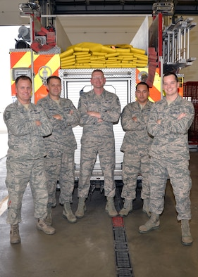 U.S. Air Force Chief Master Sgt. William Taylor, center, 100th Civil Engineer Squadron Fire Department installation fire chief, poses for a photo with some of his firefighter family Sept. 26, 2017, on RAF Mildenhall, England. Taylor was trapped, alone and almost lost his life in a fire during a training session when he was a new Airman in July 1997, aged just 20. Afterwards, he vowed to become a fire chief and that safety, training and family oriented culture would be his main focal points to ensure his team's success. (U.S. Air Force photo by Karen Abeyasekere)