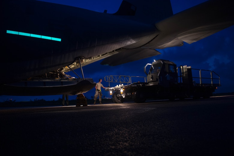 Senior Airman Wesley LaPrarie, assigned to the 821st Contingency Response Squadron, spots a K-loader at Aguadilla, Puerto Rico, Oct. 3, 2017. The 821st Contingency Response Group deployed to Puerto Rico to establish a cargo hub to receive supplies and humanitarian aid supporting Hurricane Maria relief operations across the Caribbean. (U.S. Air Force photo by Staff Sgt. Robert Hicks)