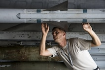 Staff Sgt. Jeffrey Kohler, 20th Aircraft Maintenance Squadron load crew team chief, inspects an AIM-120 advanced medium-range air-to-air missile during a quarterly load crew competition at Shaw Air Force Base, S.C., Oct. 4, 2017. Kohler was responsible for ensuring munitions were loaded properly. (U.S. Air Force photo by Airman 1st Class Sean Sweeney)
