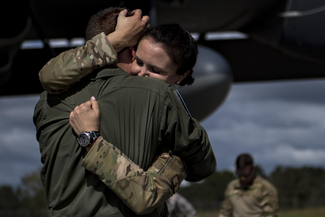 First Lt. Ashton Thibodeau, 71st Rescue Squadron combat systems officer, greets her loved one during a redeployment, Oct. 6, 2017, at Moody Air Force Base, Ga. Airmen from the 71st RQS supported deployed operations by providing expeditionary personnel with on-call recovery forces should they need rescue. (U.S. Air Force photo by Airman 1st Class Daniel Snider)