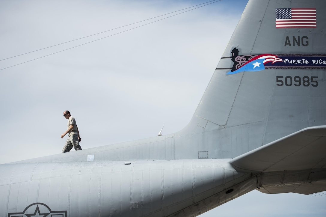 Master Sgt. José Sánchez-Nieves, a crew chief assigned to the 156th Aircraft Maintenance Squadron, inspects the wing of an WC-130E Hercules at Muñiz Air National Guard Base, Puerto Rico, Oct. 6, 2017. Hurricane Maria formed in the Atlantic Ocean and affected islands in the Caribbean Sea, including Puerto Rico and the U.S. Virgin Islands. U.S. military assets supported FEMA as well as state and local authorities in rescue and relief efforts. (U.S. Air Force photo by Tech. Sgt. Larry E. Reid Jr.)