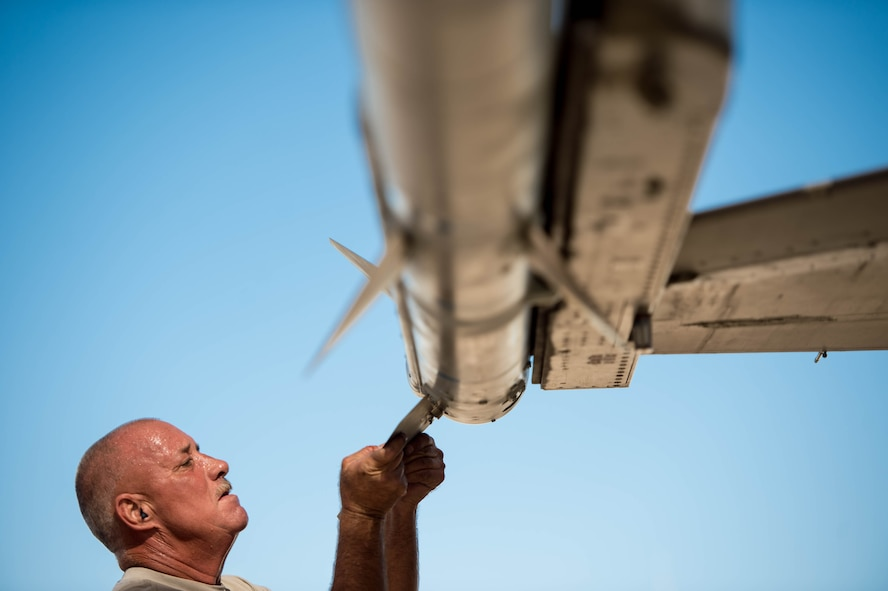 Tech. Sgt. Toby McCord, 310th Aircraft Maintenance Unit weapons load crew team leader, places a fin on an AIM-120 missile during the 56th Fighter Wing Load Crew of the Quarter competition at Luke Air Force Base, Ariz., Oct. 6, 2017. Placing all eight fins on the missile was one of the final tasks to complete the mission. (U.S. Air Force photo by Staff Sgt. Jensen Stidham)