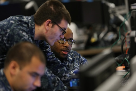 Sailors work together at a joint cyber training center during an April 2017 exercise.