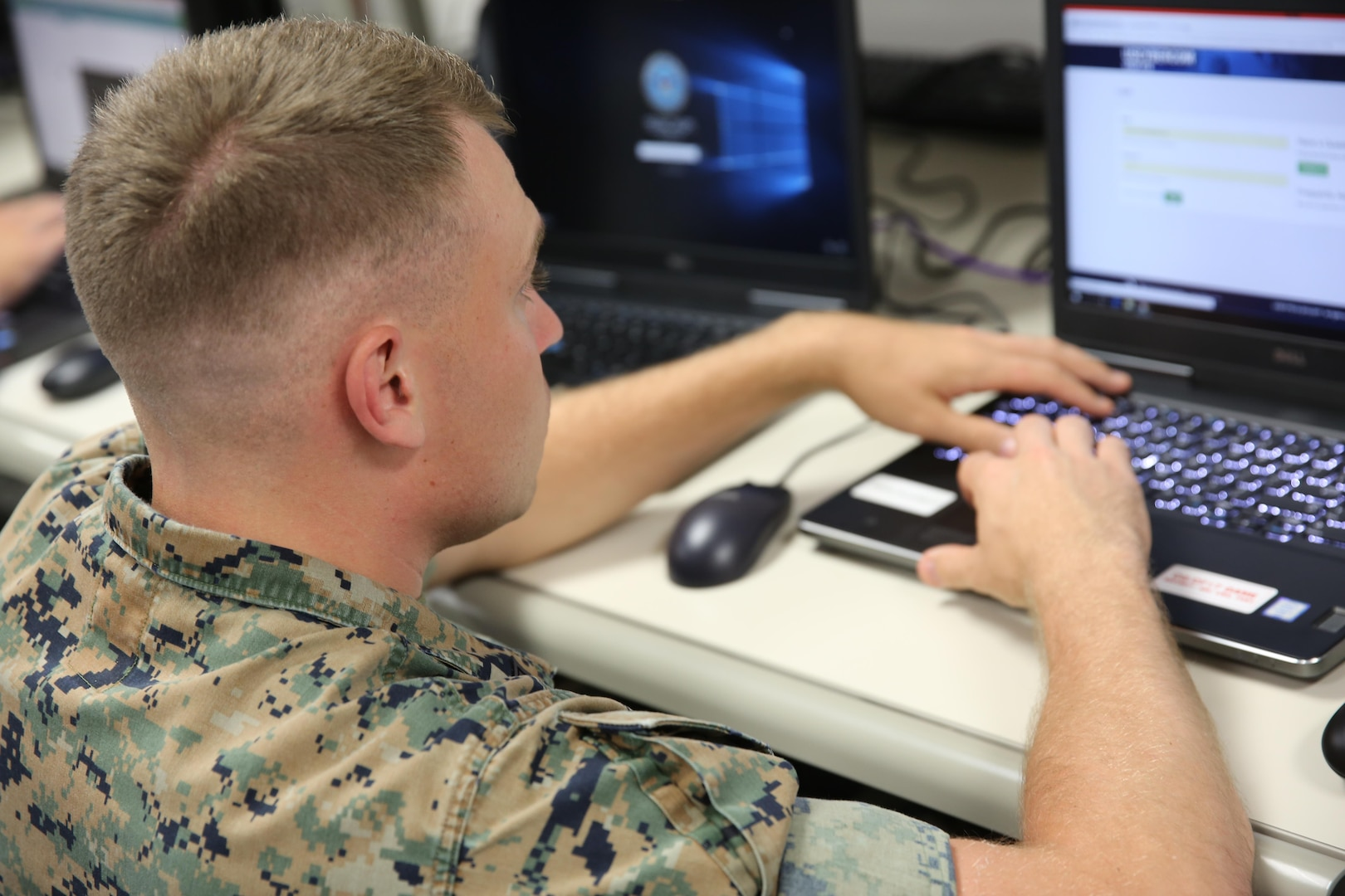 A Soldier works on his laptop during the Cyber Guard 2017 exercise June 13, 2017. Cyber Guard is a weeklong exercise that tests and exercises the men and women of U.S. Cyber Command's Cyber Mission Force and interagency partner teams from across federal and state organizations tasked with defending critical infrastructure.