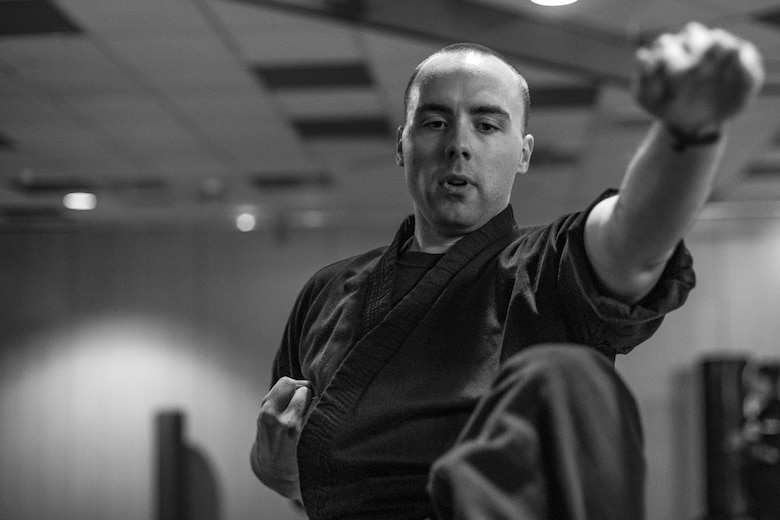 U.S. Air Force Staff Sgt. Brandon Sabin, 86th Airlift Wing Public Affairs broadcast journalist, practices forms during a mixed martial arts class at the Vogelweh Community Center on Vogelweh Military Complex, Germany, Oct. 11, 2017. Sabin has practiced five forms of martial arts over the course of 20 years. (U.S. Air Force photo by Senior Airman Devin Boyer)