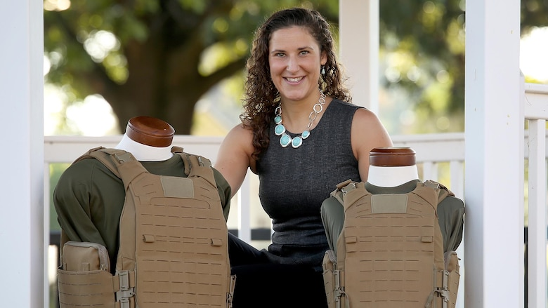 "Flora ""Mackie"" Jordan, body armor engineer at Marine Corps Systems Command, recently developed a modular body armor system that is just as effective as, but 45 percent lighter than, the body armor system Marines currently use."