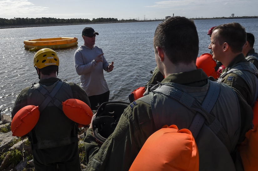 Tech. Sgt. Alan Morse, 437th OSS survival, evasion, resistance and escape NCO in charge, instructs students about water survival training as part of SERE block training prior to the students getting into the water Oct. 2, 2017.