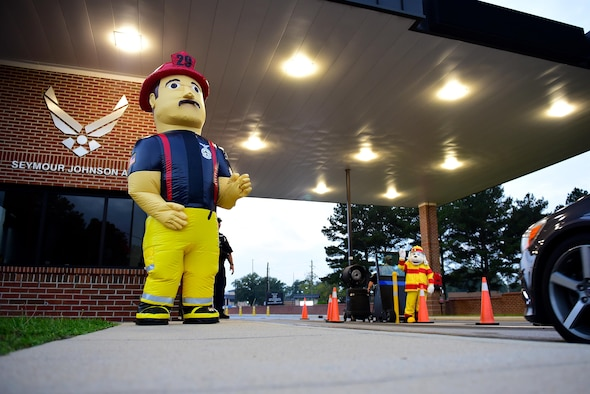 Big Bob and Sparky the Fire Dog greet members of Team Seymour as they arrive at the Oak Forest Gate, Oct. 11, 2017, at Seymour Johnson Air Force Base, North Carolina. According to the National Fire Protection Association, in 2015, an estimated 365,000 home structure fires caused 2,560 deaths, 11,075 civilian injuries, and $7 billion in damage. (U.S. Air Force photo by Airman 1st Class Kenneth Boyton)