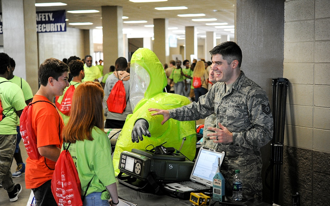 Tech. Sgt. George MacEachrern, 14th Medical Operations Squadron bioenvironmental engineer technician, shows students hazardous materials response equipment Oct. 3, 2017, during the Imagine the Possibilities Career Expo at the BancorpSouth Arena in Tupelo, Mississippi. Airmen from 14th MDOS showed some of the various careers that are available in the health field. (U.S. Air Force photo by Staff Sgt. Christopher Gross)