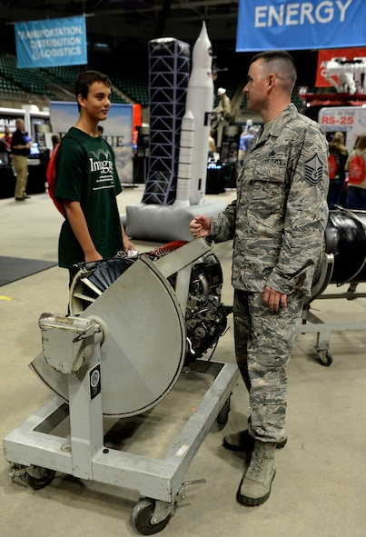 Master Sgt. Jimmy Kitchens, 14th Flying Training Wing contracting officer representative, speaks with a student about the maintenance career field options Oct. 4, 2017, during the Imagine the Possibilities Career Expo at the BancorpSouth Arena in Tupelo, Mississippi. The Air Force offers many different paths within single careers, from crew chief to aerospace propulsion, that all push the mission toward success. (U.S. Air Force photo by Airman 1st Class Keith Holcomb)