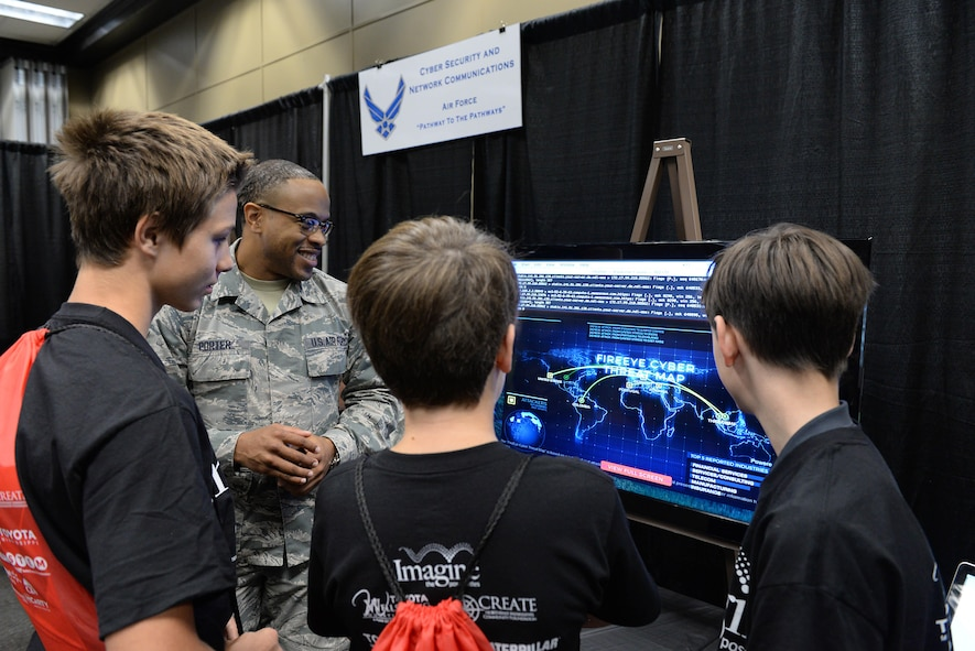 Staff Sgt. Donald Porter, 14th Communication Squadron technician, explains the mission of the U.S. Air Force's communications career field Oct. 4, 2017, at Imagine the Possibilities Career Expo at the BancorpSouth Arena in Tupelo, Mississippi. Several Air Force careers were displayed in various ways and Airmen explained to students from schools across Mississippi what opportunities the Air Force can provide. (U.S. Air Force photo by Airman 1st Class Keith Holcomb)