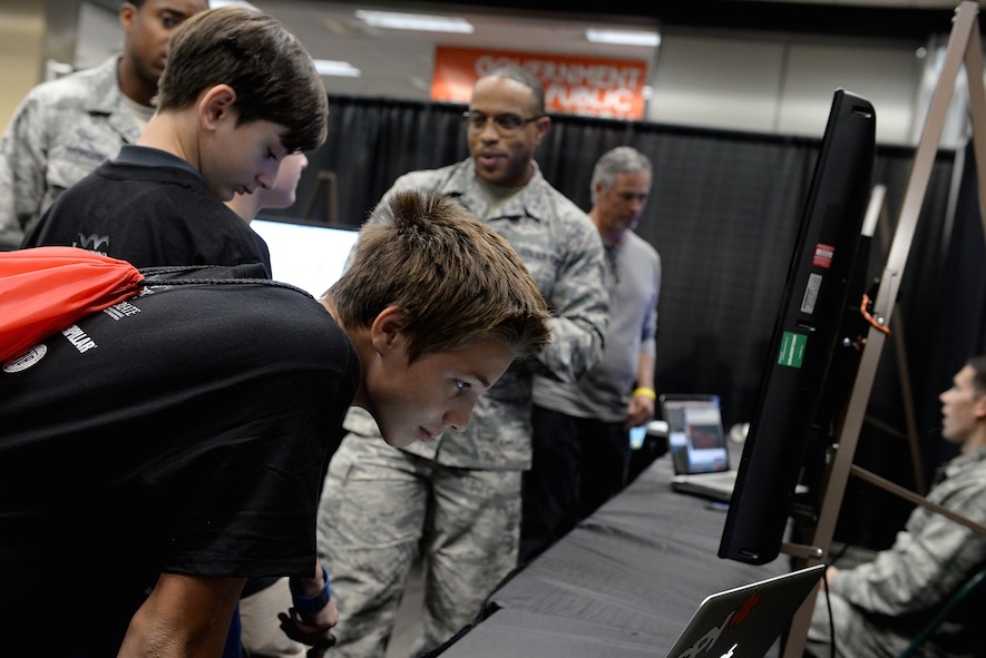Airmen from the 14th Communications Squadron talk with a group of students Oct. 4, 2017, during the Imagine the Possibilities Career Expo at the BancorpSouth Arena in Tupelo, Mississippi. The expo, hosted by the CREATE Foundation, showcased a multitude of career opportunities for more than 7,000 eighth grade students. The expo took place Oct. 3-5, and had Airmen from Columbus Air Force Base, Mississippi, from various pathways and careers explain their missions and lifestyle. (U.S. Air Force photo by Airman 1st Class Keith Holcomb)