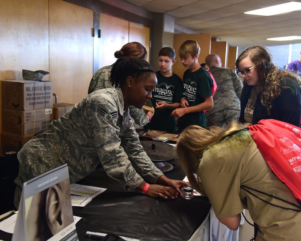 Senior Airman Brianna Brown, 14th Medical Operations Squadron public health technician, talks with students Oct. 3, 2017, during the Imagine the Possibilities Career Expo at the BancorpSouth Arena in Tupelo, Mississippi. Airmen from Columbus Air Force Base, Mississippi, showcased a total of 21 careers at the expo. (U.S. Air Force photo by Elizabeth Owens)