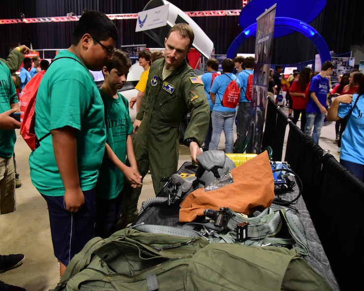 Capt. Andrew Richter, 37th Flying Training Squadron Commander's Executive Assistant, talks with students Oct. 4, 2017, during the Imagine the Possibilities Career Expo at the BancorpSouth Arena in Tupelo, Mississippi. Airmen from Columbus Air Force Base, Mississippi, represented seven pathways showcasing 21 careers. (U.S. Air Force photo by Elizabeth Owens)