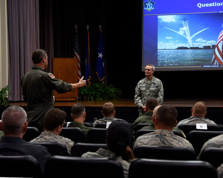 Lt. Gen. Darryl L. Roberson, commander of Air Education and Training Command, converses with 14th Flying Training Wing leadership during an AETC Senior Leader All-Call Oct. 5, 2017, on Columbus Air Force Base, Mississippi.  Roberson and AETC Command Chief Master Sergeant Juliet C. Gudgel spoke about future changes and ideas that can be implemented throughout their bases, groups and squadrons to more efficiently lead their students and Airmen.