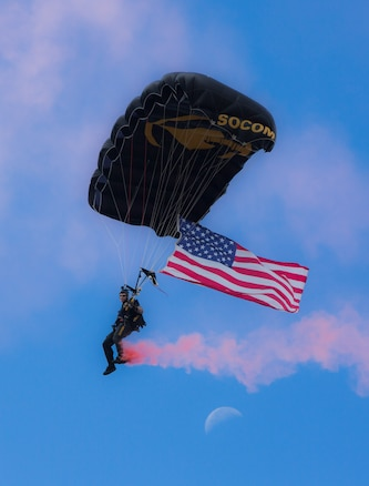 A Para-Commando of the United States Special Operations Command Parachute Team drops in over MacDill Air Force Base, October 13, 2017. The Para-Commandos are the U.S. Special Operations Command's premier aerial parachute demonstration team. (Department of Defense photo by Tom Gagnier)