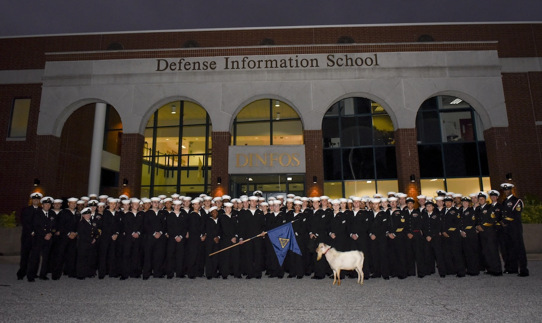 DINFOS staff and students pose with a goat, Oct. 17, 2017.