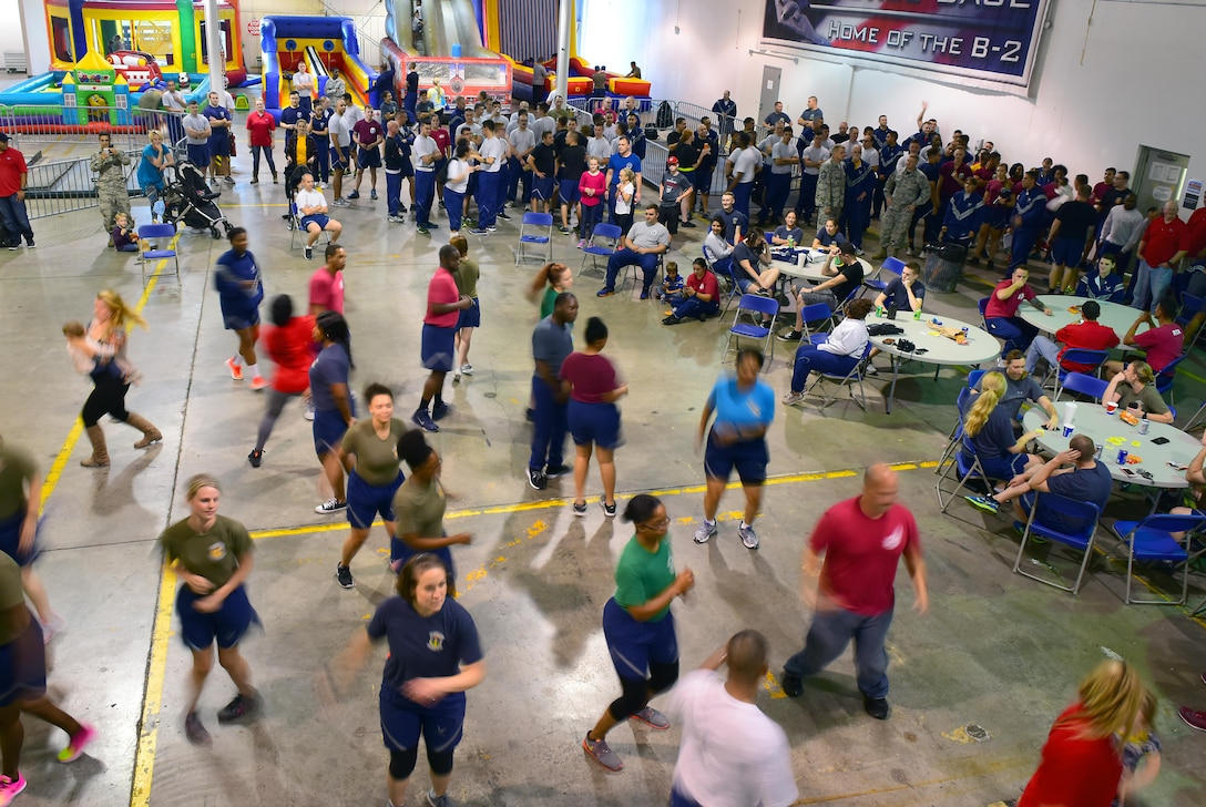Members of Team Whiteman dance to the Electric Slide prior to the culmination ceremony for the 2017 Comprehensive Airman Fitness Day at Whiteman Air Force Base, Mo., Oct. 6, 2017.