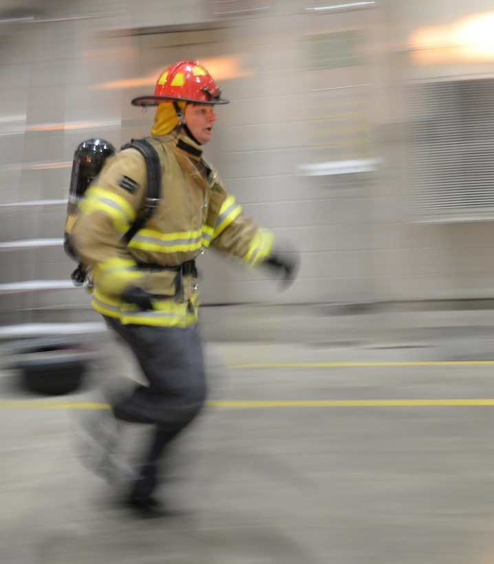 David Olson, the 28th Civil Engineer Squadron Fire Protection Flight chief, runs between obstacles during the Firefighter Challenge at Ellsworth Air Force Base, S.D., Oct. 6, 2017. During National Fire Prevention Week, multiple teams competed against one another on a course designed to test the strength, agility and precision of each member in the four-person teams. (U.S. Air Force photo by Airman 1st Class Thomas Karol)