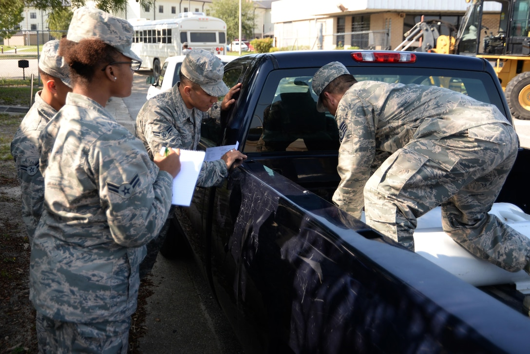 Tech. Sgt. Guillermo Gutierrez, 81st Logistics Readiness Squadron fleet management and analysis NCO in charge, briefs Airmen on how to install a propane kit Oct. 13, 2017, on Keesler Air Force Base, Mississippi. Thirteen vehicles were selected to have propane kits installed as part of a year-long Defense Department study to determine the environmental effects of using propane instead of gasoline in vehicles. (U.S. Air Force photo by Airman 1st Class Suzanna Plotnikov)
