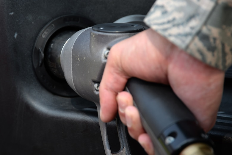 Tech. Sgt. Guillermo Gutierrez, 81st Logistics Readiness Squadron fleet management and analysis NCO in charge, fills a propane tank Oct. 13, 2017, on Keesler Air Force Base, Mississippi. Thirteen vehicles were selected to have propane kits installed as part of a year-long Defense Department study to determine the environmental effects of using propane instead of gasoline in vehicles. (U.S. Air Force photo by Airman 1st Class Suzanna Plotnikov)