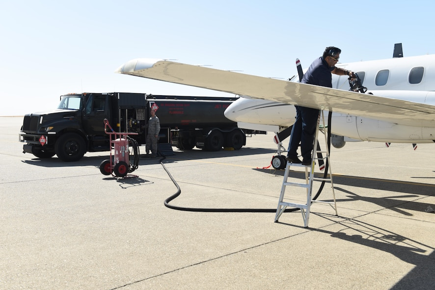 Staff Sgt. Mathew Stone, 9th Logistics Readiness Squadron fuels distribution, and Albert Goodly 9th Mission Support Group aircraft repairman, refuel a California  Air National Guard RC-26 aircraft at Beale Air Force Base, California
