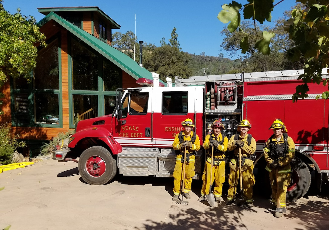 Firefighters from the 9th Civil Engineer Squadron stand by their fire engine during the California wildfires.