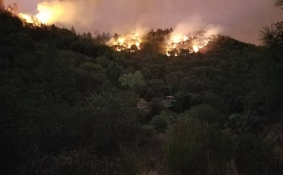 A fire burns along a ride during the California wildfires