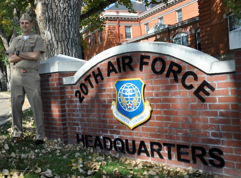Photo in front of 20th HQ sign