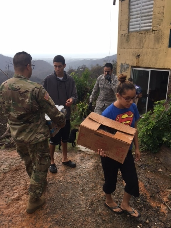 Airmen help deliver food and water to local villages during Hurricane Maria relief efforts, Ponce, Puerto Rico. (Courtesy Photo)