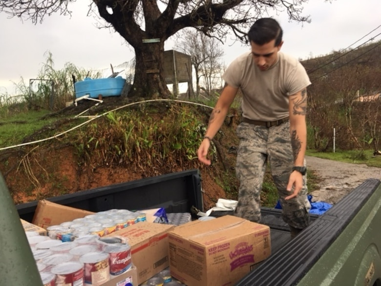 An Airman helps deliver food and water to local villages during Hurricane Maria relief efforts, Ponce, Puerto Rico. (Courtesy Photo)