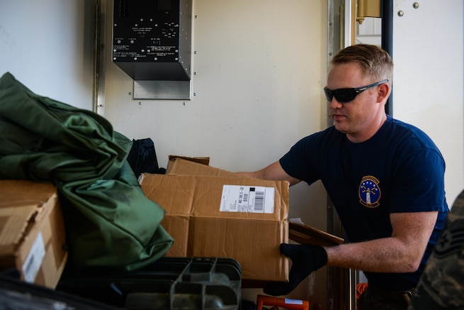 Staff Sgt. Skyler Hart, 85th Engineering Installation Squadron quality assurance, loads equipment into a cargo container for a deployment to aid Puerto Rico at the 85th EIS Vehicle Operations building on Keesler Air Force Base, Mississippi. In the wake of Hurricane Maria, Puerto Rico's land mobile radio communications infrastructure for first responders are in dire need of repair and the 85th EIS were requested by name to help get it back up and running. (U.S. Air Force photo by Senior Airman Travis Beihl)