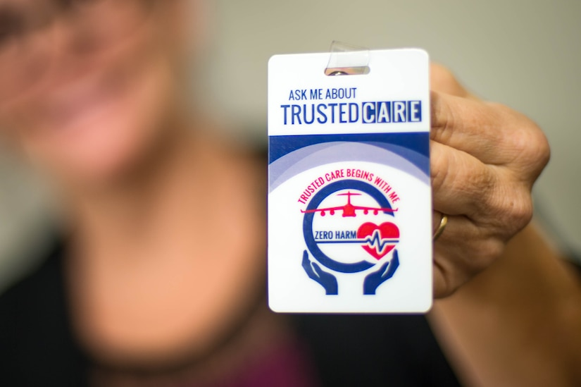 """The """"Trusted Care"""" badge serves as a reminder for the entire U.S. Air Force Medical Service (AFMS) to provide exemplary patient-centered care at every level. In order to ensure the patient is placed at the center of their care, Trusted Care has teamed up with the Institute of Healthcare Improvement (IHI) to develop an effective training program. Training is aimed at fostering a culture of safety from front-line providers to senior leaders. (U.S. Air Force photo by SSgt Jensen Stidham)"""