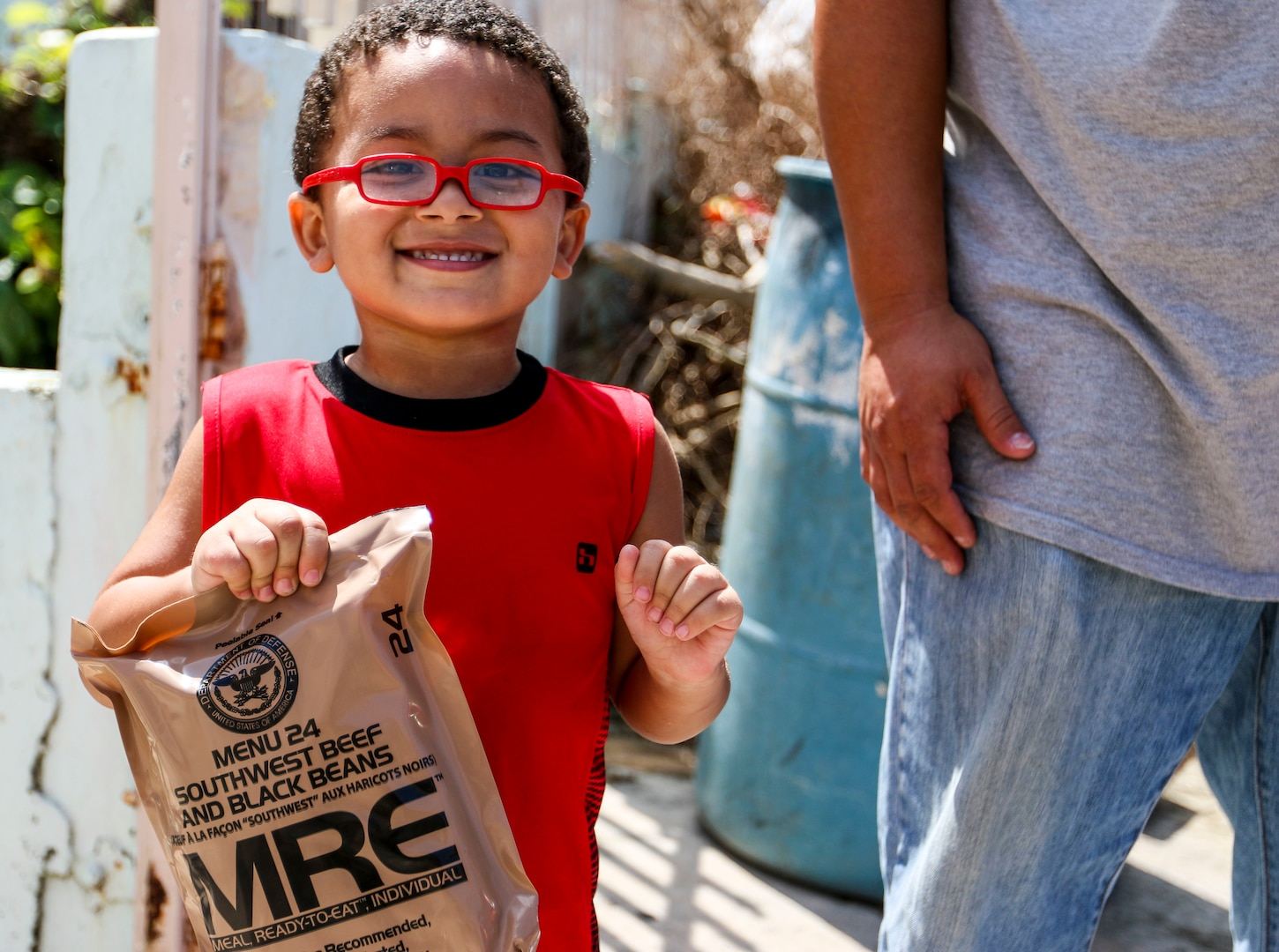 A boy smiles after receiving a packaged meal in San Juan, Puerto Rico.