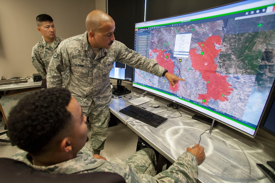 Staff Sgt. Richard Glover, 163d Attack Wing IT Specialist, shows burn areas to Staff Sgt. Jamel Seales (sitting) and Staff Sgt. Shawn Blue (background) on Saturday, Oct. 14, 2017, at the wing's Hap Arnold Center at March Air Reserve Base, California.