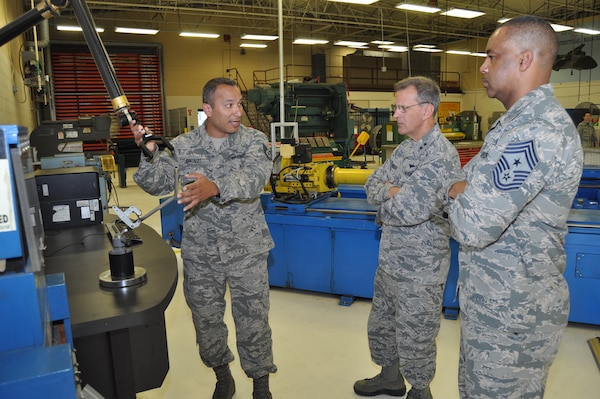 Tech. Sgt. John Gonzalez, 433rd Maintenance Squadron structural maintenance technician, demonstrates to 4th Air Force leadership how the technology available to his shop helps improve practices and increases production.  Maj. Gen. Randall Ogden, 4th Air Force commander, and Chief Master Sgt. Timothy White, Jr., 4th AF command chief, were visiting squadrons within the 433rd Maintenance Group Oct. 15, 2017 during their four-day visit to the Alamo Wing. (U.S. Air Force photo/Senior Airman Bryan Swink)