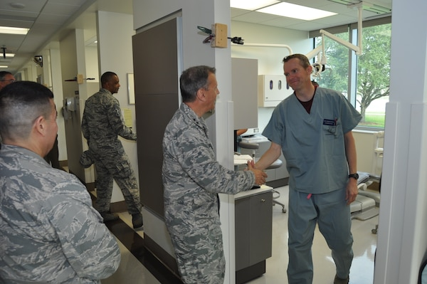 Maj. Gen. Randall Ogden, 4th Air Force commander, meets Maj. Jered King, 433rd Aerospace Medical Squadron dentist, during his visit to the Air Force Postgraduate Dental School & Clinic Oct. 14, 2017. Gen. Ogden, along with Chief Master Sgt. Timothy White, Jr., 4th AF command chief, spent four days visiting with the 433rd Airlift Wing's Citizen Airmen and receiving a first-hand look at the Alamo Wing's operations within Joint Base San Antonio. (U.S. Air Force photo/Senior Airman Bryan Swink)