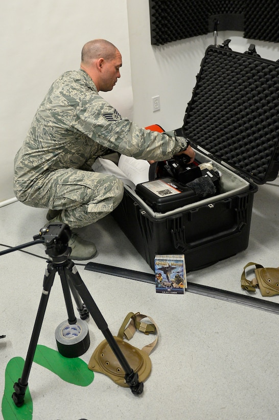 U.S. Airman Staff Sgt. Brian Jarvis, broadcaster, 129th Rescue Wing, Moffett Air National Guard Base, Calif., checks over his camera gear in preparation for an overseas deployment, October 15, 2017. (U.S. Air National Guard photo by Master Sgt. Ray Aquino/released)