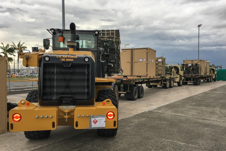 Airmen from the Kentucky Air National Guard's 123rd Contingency Response Group, augmented by troops from the active-duty Air Force and Air National Guard units in multiple states, load relief supplies onto trucks for distribution at Luis Muñoz Marín International Airport in San Juan, Puerto Rico, in the wake of Hurricane Maria Oct. 5, 2017. The unit's Airmen established an aerial port of debarkation upon arrival here Sept. 23, and have processed more than 7.2 million pounds of cargo and humanitarian aid for distribution in the first three weeks of the operation. (U.S. Air National Guard photo by Lt. Col. Dale Greer)
