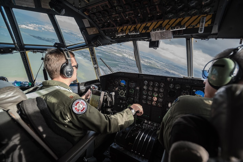 A C-130 aircrew from the Georgia Air National Guard's 165th Airlift Wing approaches Puerto Rico with a load of humanitarian aid being flown from Savannah, Ga., to Luis Muñoz Marín International Airport in San Juan on Oct. 5, 2017. The cargo will be downloaded and staged for distribution by Airmen from the Kentucky Air Guard's 123rd Contingency Response Group as part of Hurricane Maria recovery efforts. (U.S. Air National Guard photo by Lt. Col. Dale Greer)
