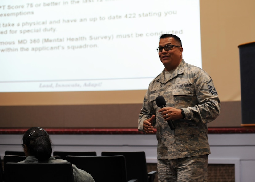 Master Sgt. Carlos Recoder, a military training instructor assigned to the 433rd Training Squadron, briefs members of the 446th Airlift Wing during the wing commanders call Oct. 15, 2017 at McChord Field, Wash.