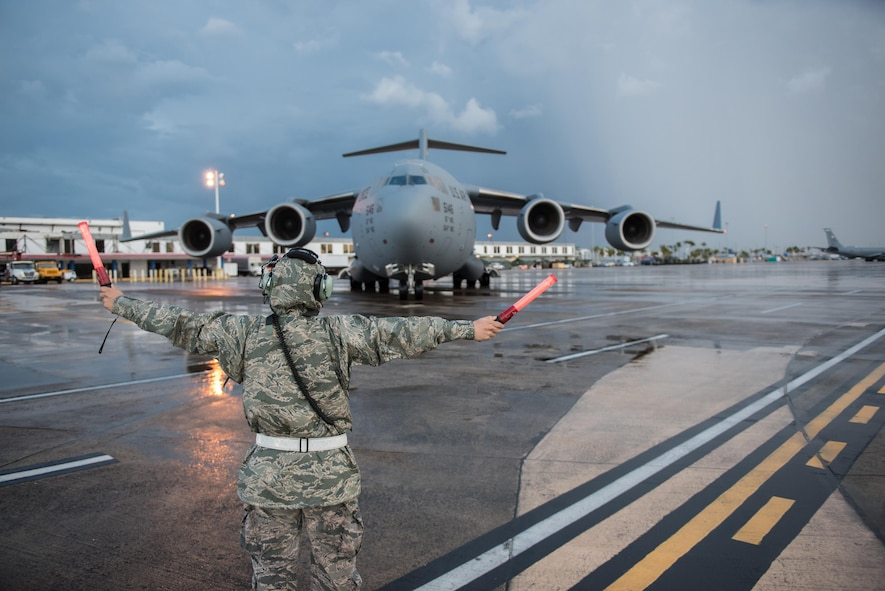 An Airman from the Kentucky Air National Guard's 123rd Contingency Response Group parks a U.S. Air Force C-17 Globemaster III at Luis Muñoz Marín International Airport in San Juan, Puerto Rico, on Oct. 6, 2017. The aircraft is carrying relief supplies to assist with recovery efforts following Hurricane Maria. (U.S. Air National Guard photo by Lt. Col. Dale Greer)