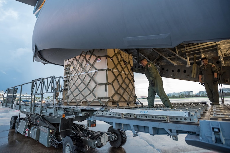 Loadmasters from the Hawaii Air National Guard dowload relief supplies from their C-17 aircraft at Luis Muñoz Marín International Airport in San Juan, Puerto Rico, in the wake of Hurricane Maria Oct. 6, 2017. An aerial port of debarkation at the airport has processed more than 7.2 million pounds of cargo and humanitarian aid since Sept. 23. (U.S. Air National Guard photo by Lt. Col. Dale Greer)