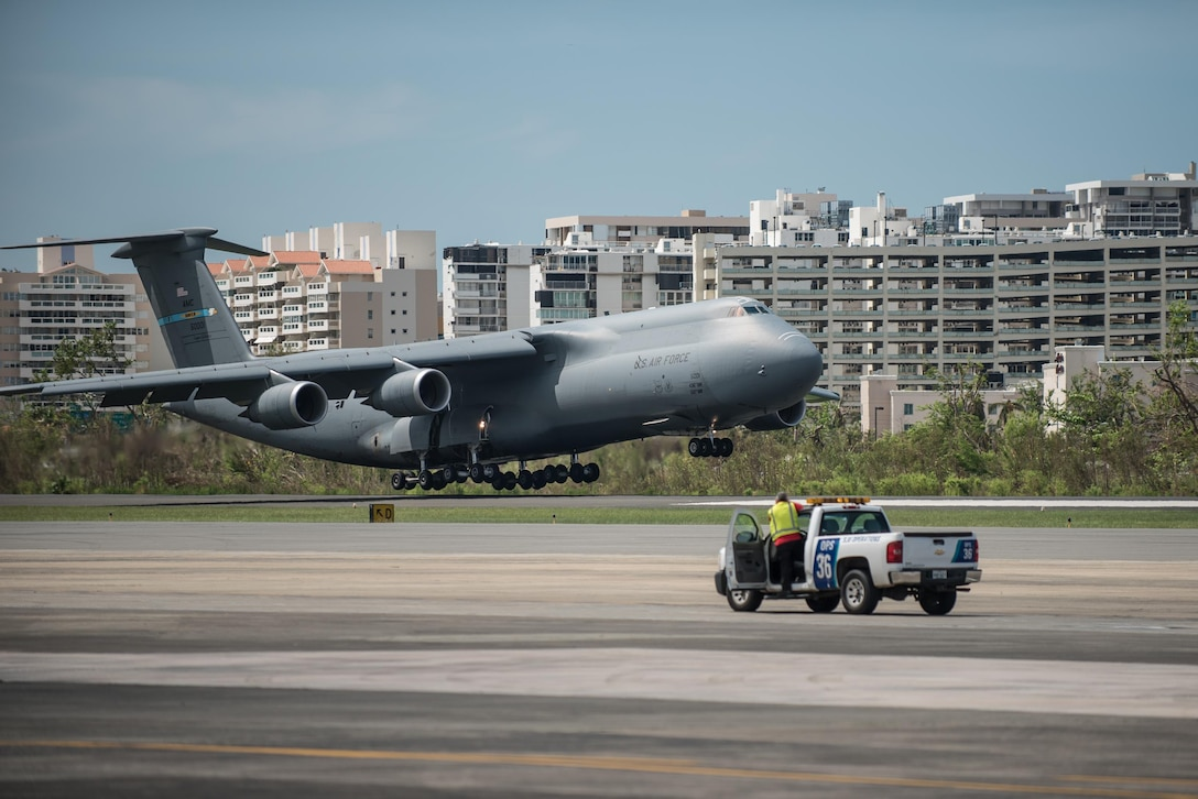 A U.S. Air Force C-5 Galaxy loaded with humanitarian aid lands at Luis Muñoz Marín International Airport in San Juan on Oct. 5, 2017. The cargo will be downloaded and staged for distribution by Airmen from the Kentucky Air Guard's 123rd Contingency Response Group as part of Hurricane Maria recovery efforts. (U.S. Air National Guard photo by Lt. Col. Dale Greer)