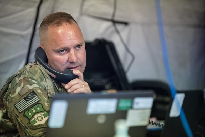 Maj. James Embry, director of operations for the Kentucky Air National Guard's 123rd Contingency Response Group, coordinates the arrival of military aircraft carrying humanitarian aid into Luis Muñoz Marín International Airport in San Juan, Puerto Rico, on Oct. 7, 2017. More than 7.2 million pounds of relief supplies for Hurricane Maria have arrived here since Sept. 23. (U.S. Air National Guard photo by Lt. Col. Dale Greer)