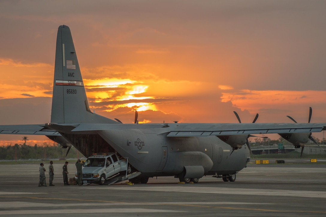 Airmen from the Kentucky Air National Guard's 123rd Contingency Response Group, augmented by troops from the active-duty Air Force and Air National Guard units in multiple states, dowload relief equipment from a C-130 Hercules aircraft at Luis Muñoz Marín International Airport in San Juan, Puerto Rico, in the wake of Hurricane Maria Oct. 6, 2017. The unit's Airmen established an aerial port of debarkation upon arrival here Sept. 23, and have processed more than 7.2 million pounds of cargo and humanitarian aid for distribution in the first three weeks of the operation. (U.S. Air National Guard photo by Lt. Col. Dale Greer)